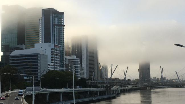 Fog starts to clear over Brisbane this morning. Picture: Liam Kidston