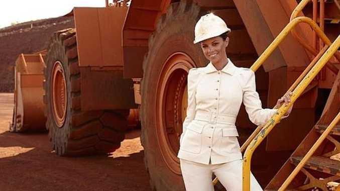 Bianca Rinehart in the Pilbara in a white Gucci suit. She has served a subpoena on Barnaby Joyce.