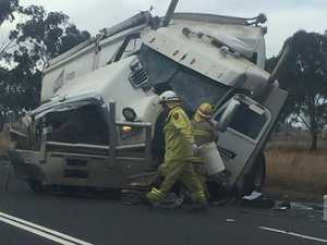 One trapped as two trucks collide west of Toowoomba