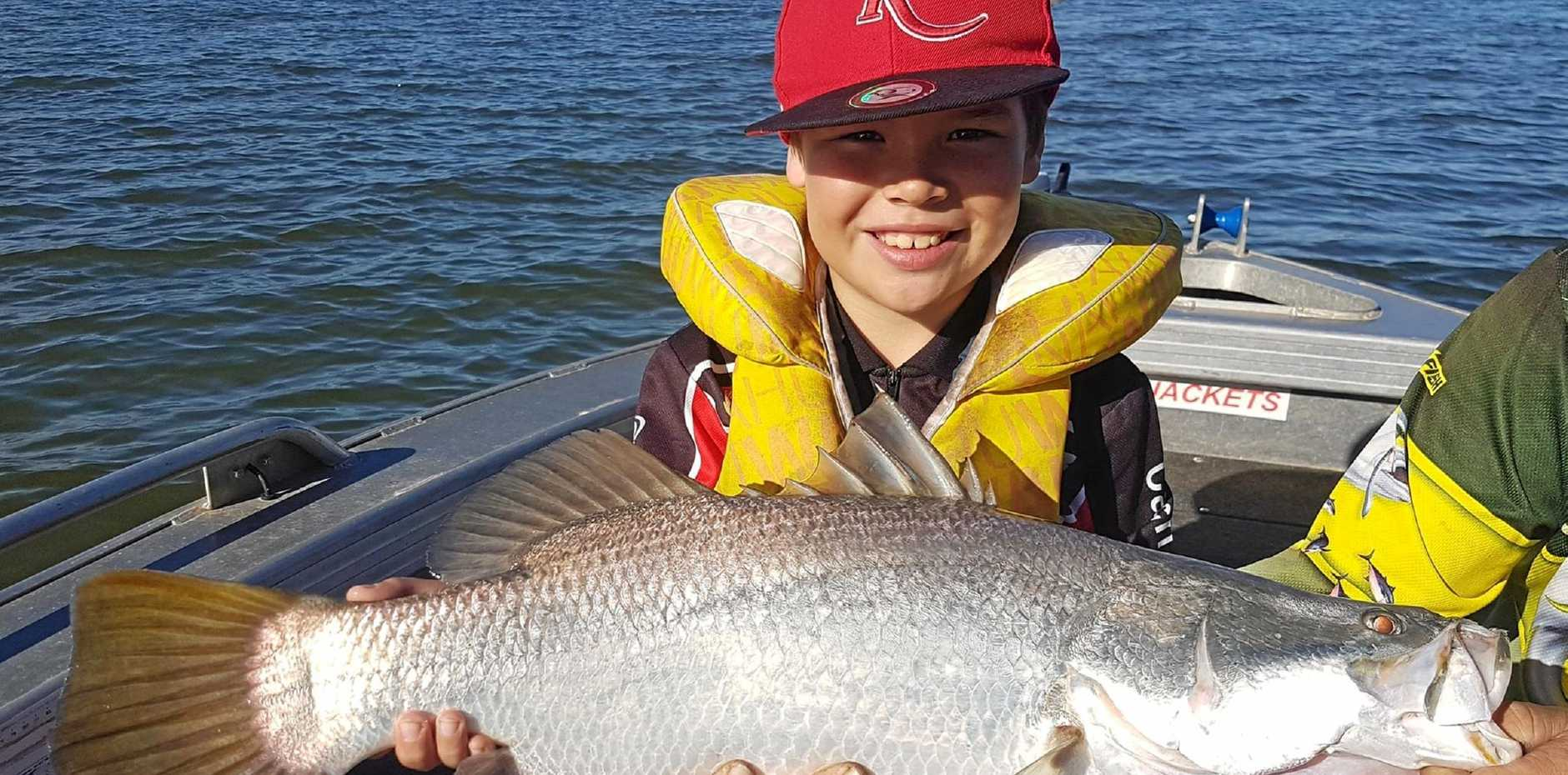 TOP CATCH: Cody Tamati with his first baramundi he landed with his grandmother.