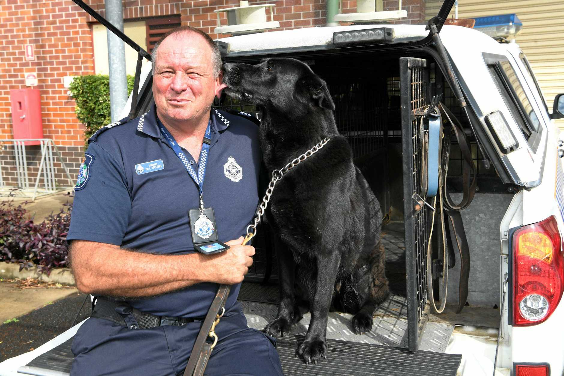 COMMUNITY HERO: Dog handler Sergeant Bill Applebee with Angel.
