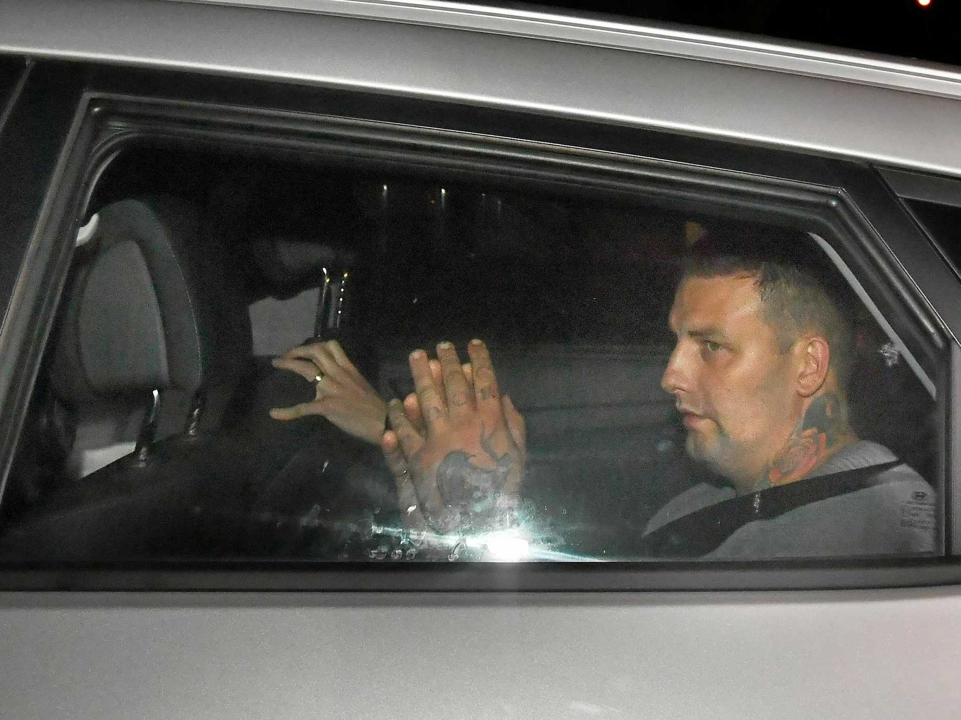 Zlatko Sikorsky is seen in a police vehicle arriving to Maroochydore Police Station, Queensland,  Saturday, June 30, 2018.  Sikorsky, 34, was arrested early Saturday night when he surrendered to police after a siege at an Alexandra Headlands unit complex on Queensland?s Sunshine Coast that began on Friday afternoon. (AAP Image/Darren England) NO ARCHIVING