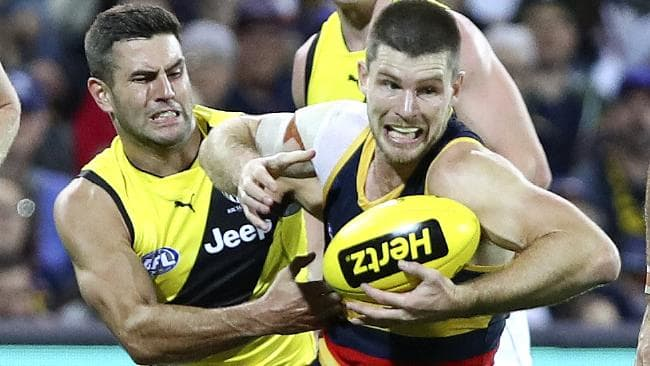 Richmond's Jack Graham and Adelaide's Bryce Gibbs contest possession. Picture: Sarah Reed
