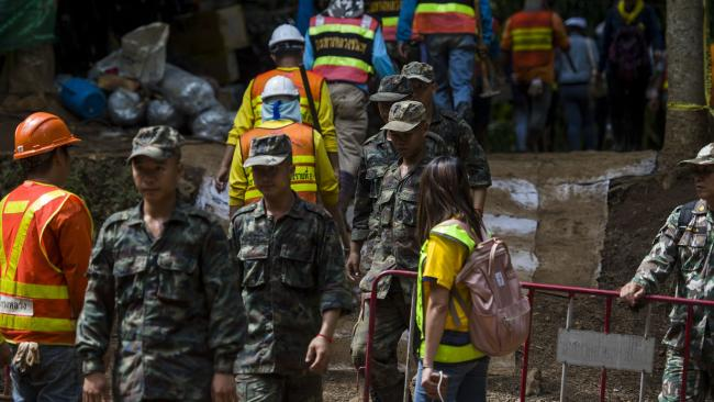 Thai soldiers and volunteers are seen at the entrance of Tham Luang cave. Picture: Ye Aung Thu