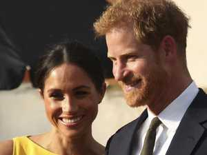 Loved-up Harry and Meghan shun royal protocol