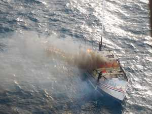 Man forced to abandon burning yacht off Coast beach