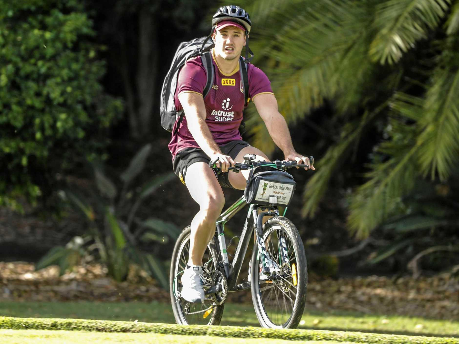 Corey Oates heads for a Maroons training session at the InterContinental Sanctuary Cove Resort on the Gold Coast. Picture: Glenn Hunt/AAP
