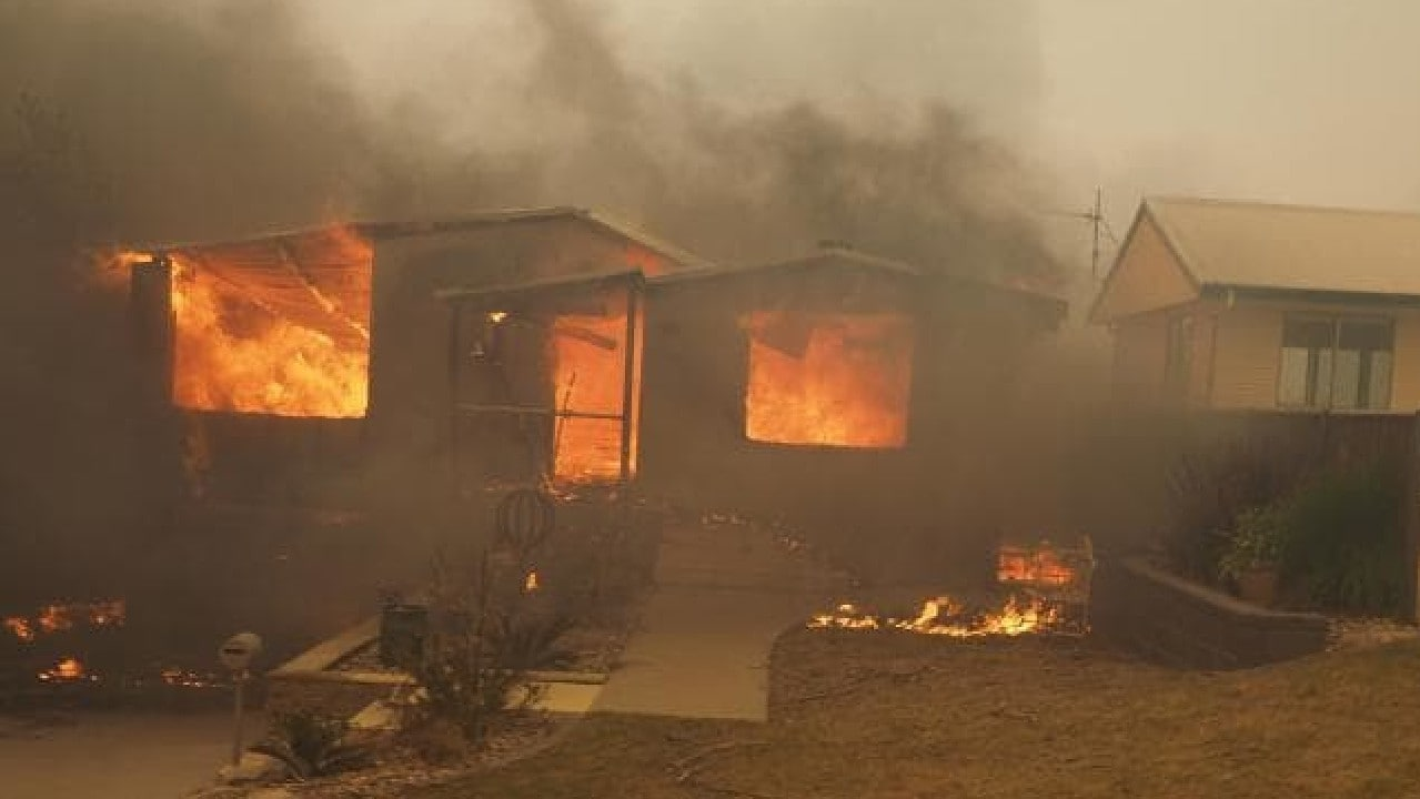 Fire guts a home in the coastal town. Picture: Twitter /Jessie Collins