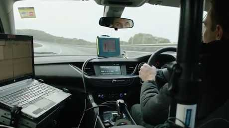 Holden engineer Rob Trubiani testing a German Holden Commodore at the Lang Lang proving ground on the south-eastern outskirts of Melbourne. Picture: Supplied.