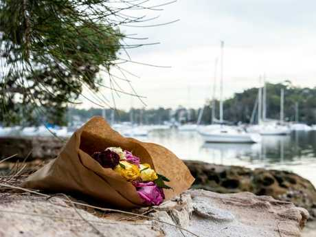 Flowers placed on the Lane Cove River shoreline at Woolwich where Cecilia Haddad's body was found in April. Picture: NewsCorp