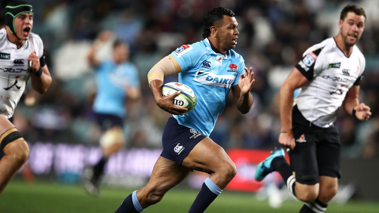Waratahs star Kurtley Beale on his way to the tryline.