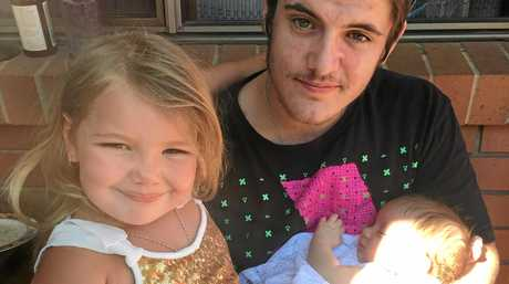 Nambour father Nickolas Robertson with his daughters Madaline Wyer, now 6, and Ella Wyer, 2. Nickolas died in hospital on Saturday after suffering a gunshot wound to the neck on July 1.