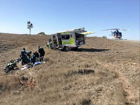 Paramedics treat seriously injured rider Don Smith after a motorbike accident on the Glenroy Marlborough Rd about 30km south of Marlborough.