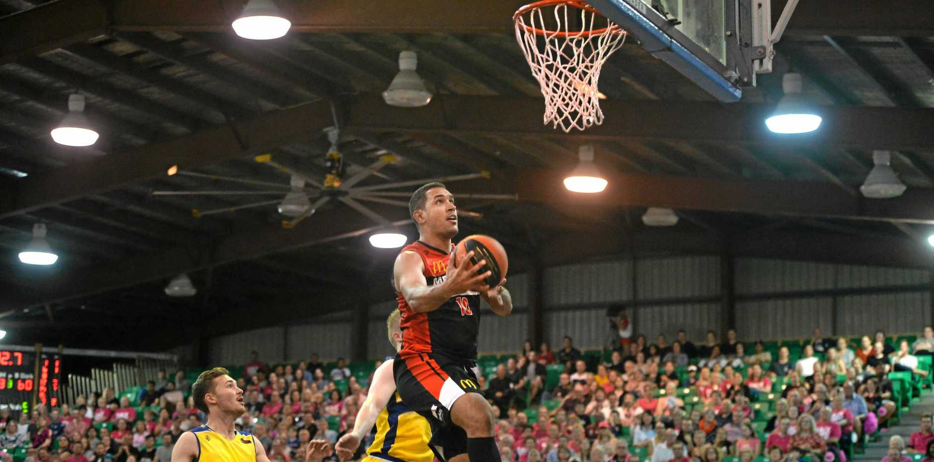 Mackay Meteors' Chris Cedar drives to the basket against the Townsville Heat in round 11 of the QBL at the Crater, Mackay on Saturday, July 8, 2018.