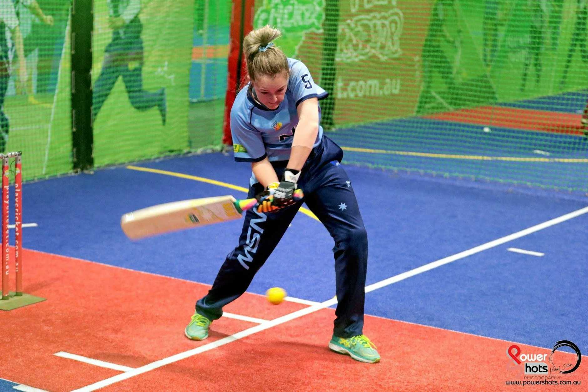 PRECISION: Amy Riddell drives through a delivery during the Indoor Cricket National Championships.