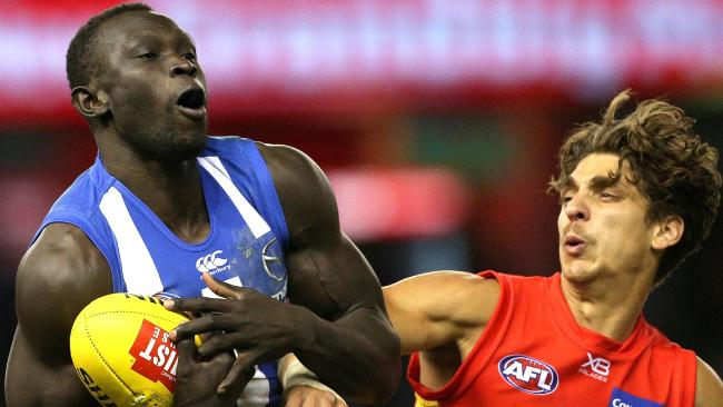 Kangaroos big man Majak Daw gets the jump on his Suns rival. Picture: AAP Images