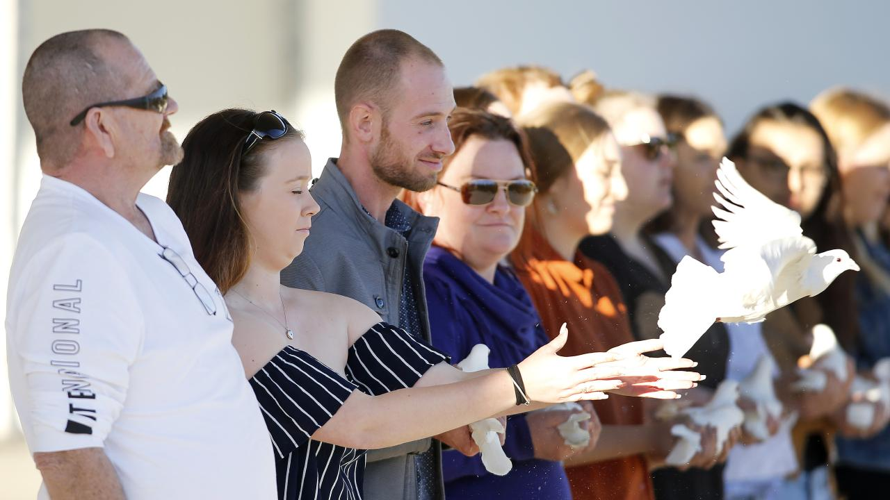 Nathan, Peter and Deanna Beilby pictured releasing doves at the memorial service for Larissa Beilby at Pine Rivers Park. Picture: AAP/Josh Woning