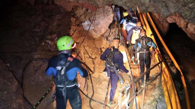 The mission to free the 12 boys  and their coach from the cave is underway.