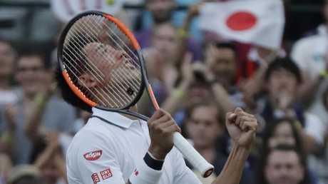 Kei Nishikori celebrates defeating Nick Kyrgios in their men's singles match. Picture: AP