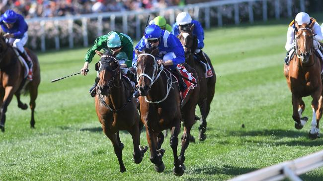 Hugh Bowman pilots Winx to a record-equalling third Cox Plate last year. Picture: AAP