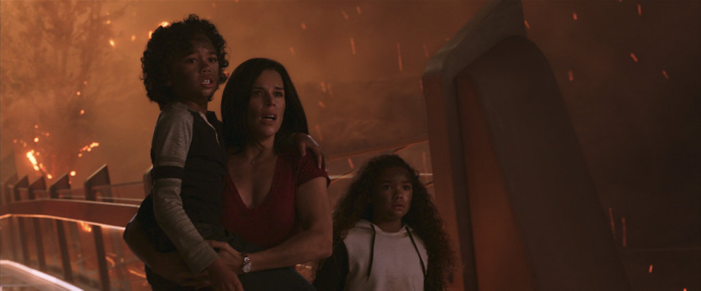 Noah Cottrell, Neve Campbell and McKenna Roberts in a scene from Skyscraper.