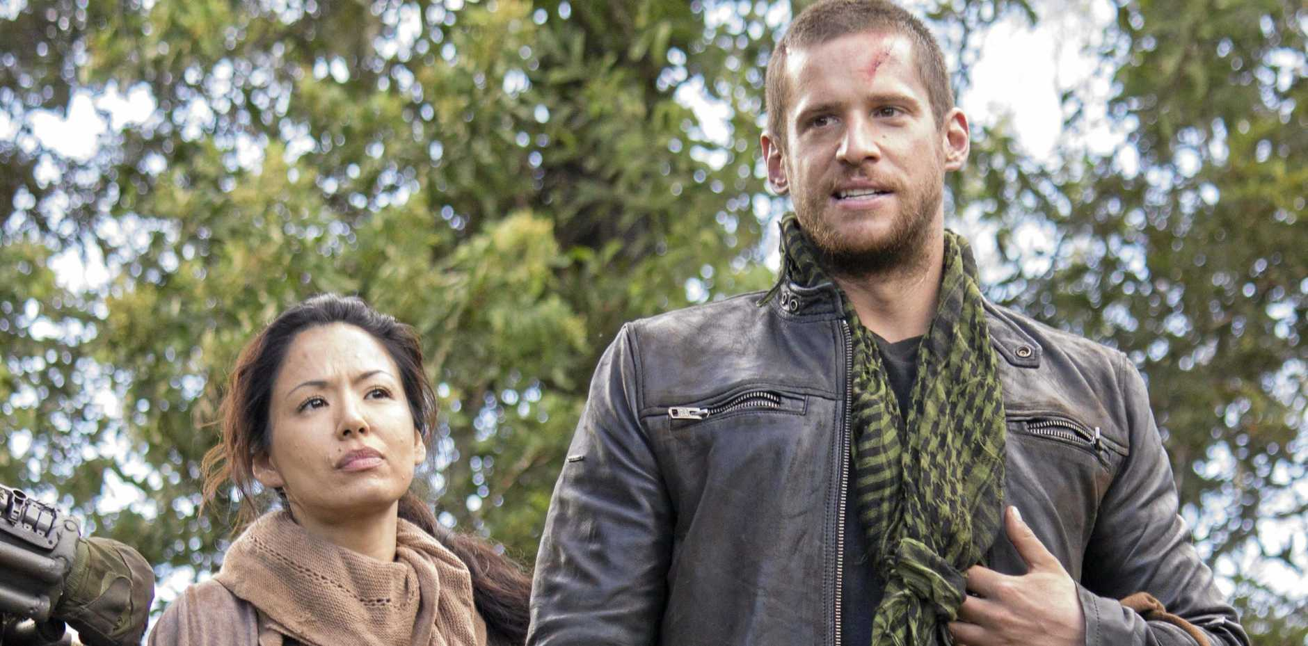 Stephany Jacobsen and Dan Ewing in a scene from the movie Occupation.