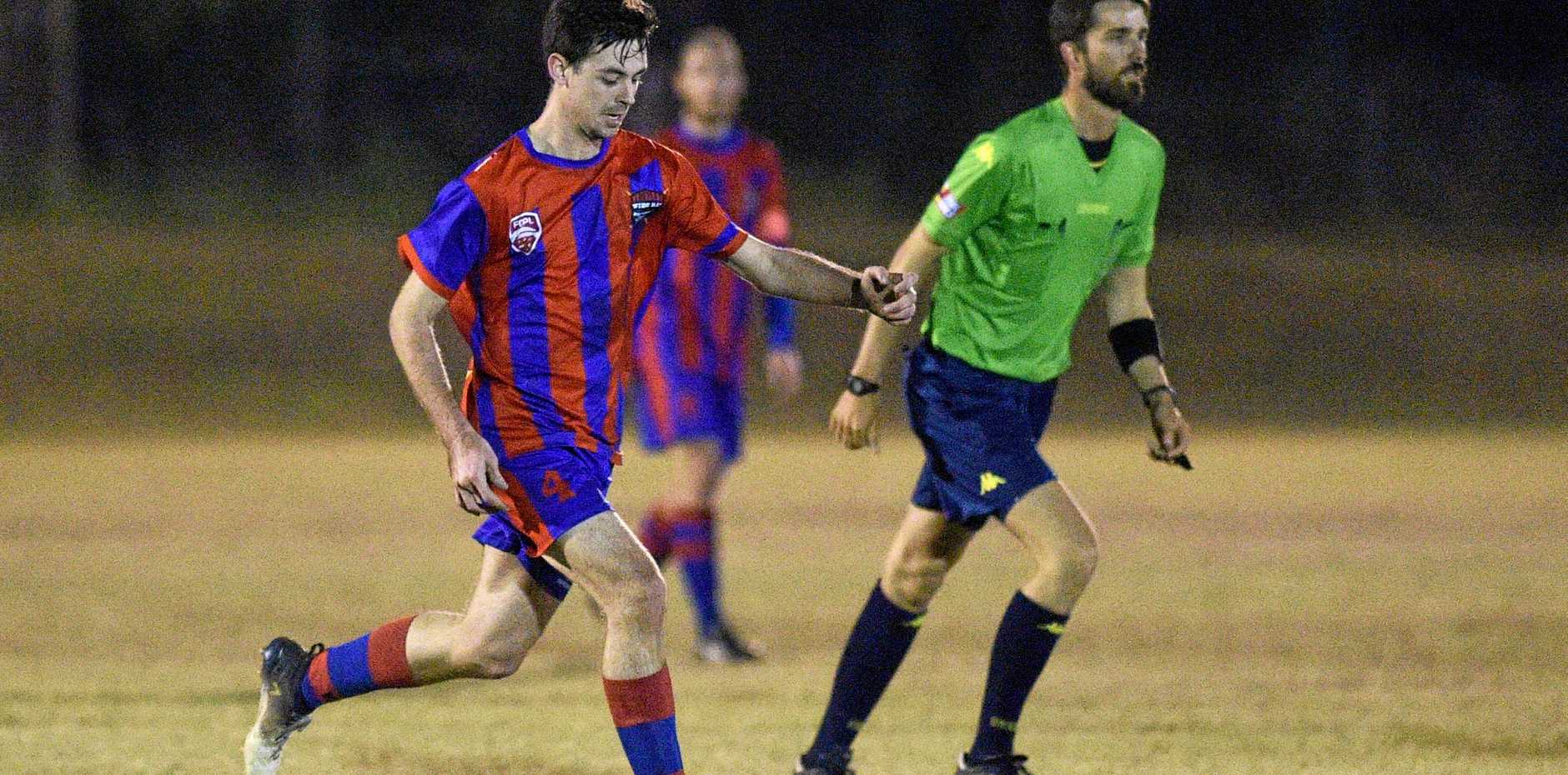 FIGHTING SPIRIT: Wide Bay Buccaneers' Shaun Mitchell takes up the ball against Capalaba Bulldogs.