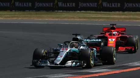 Lewis Hamilton lead Sebastian Vettel eaely in the race before things started falling apart. Picture: Getty
