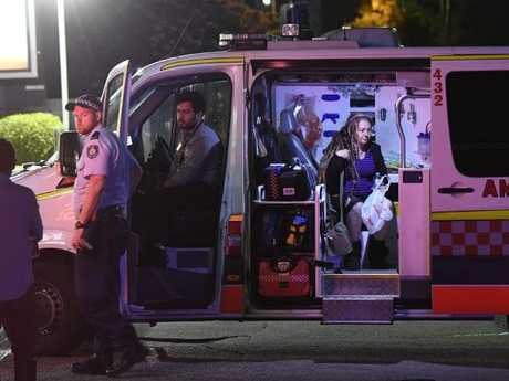 Sharon Hacker sits in an ambulance at the Enmore convenience store in the hour after she was injured. Picture: Gordon McComiskie