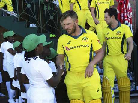 Australian captain Aaron Finch greets local juniors before the final in Harare. Picture: AP