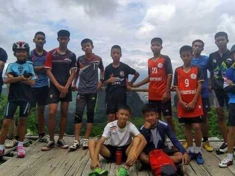 All 12 boys, soccer coach rescued from flooded Thai cave