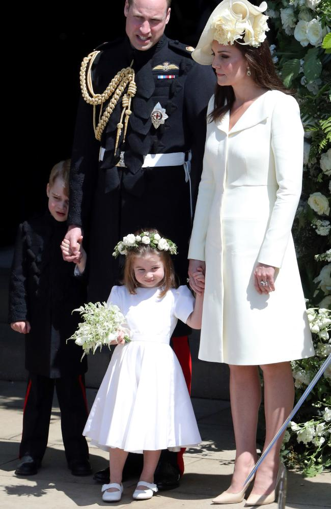 Charlotte was happy to be front and centre, while a shy George hid behind his father, Prince William, at Harry and Meghan's wedding. Picture: Andrew Matthews/WPA Pool/Getty Images