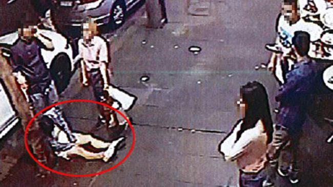 CCTV footage taken from the bar shows one of the woman slumped against a tree on the footpath. Picture: AAP/Supplied by Liquor and Gaming NSW