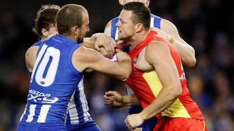 Steven May gets into a scuffle with North Melbourne players.