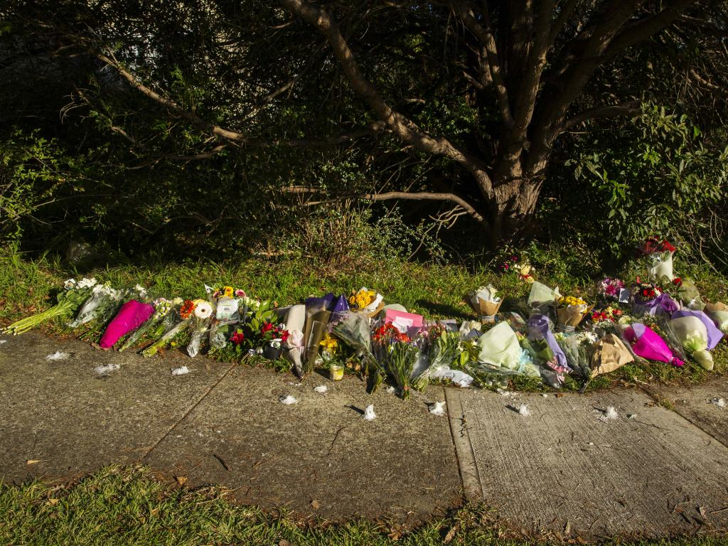 Floral tributes line the sidewalk at the house where two kids were murdered by their father, in West Pennant Hills. Picture: Jenny Evans