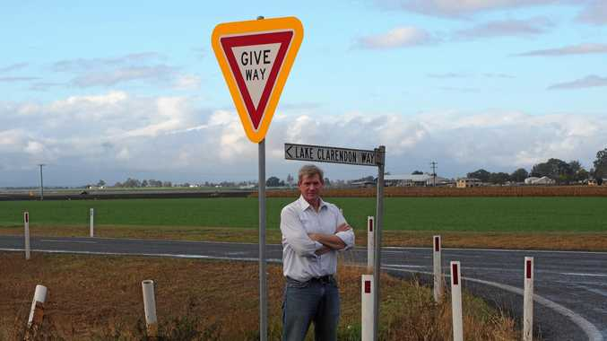 NOT ENOUGH: Member for Lockyer Jim McDonald stands at the intersection of the notorious Forest Hill-Fernvale Road and Lake Clarendon Way, which has resulted in fatalities. He believes more can be done to improve the intersection.