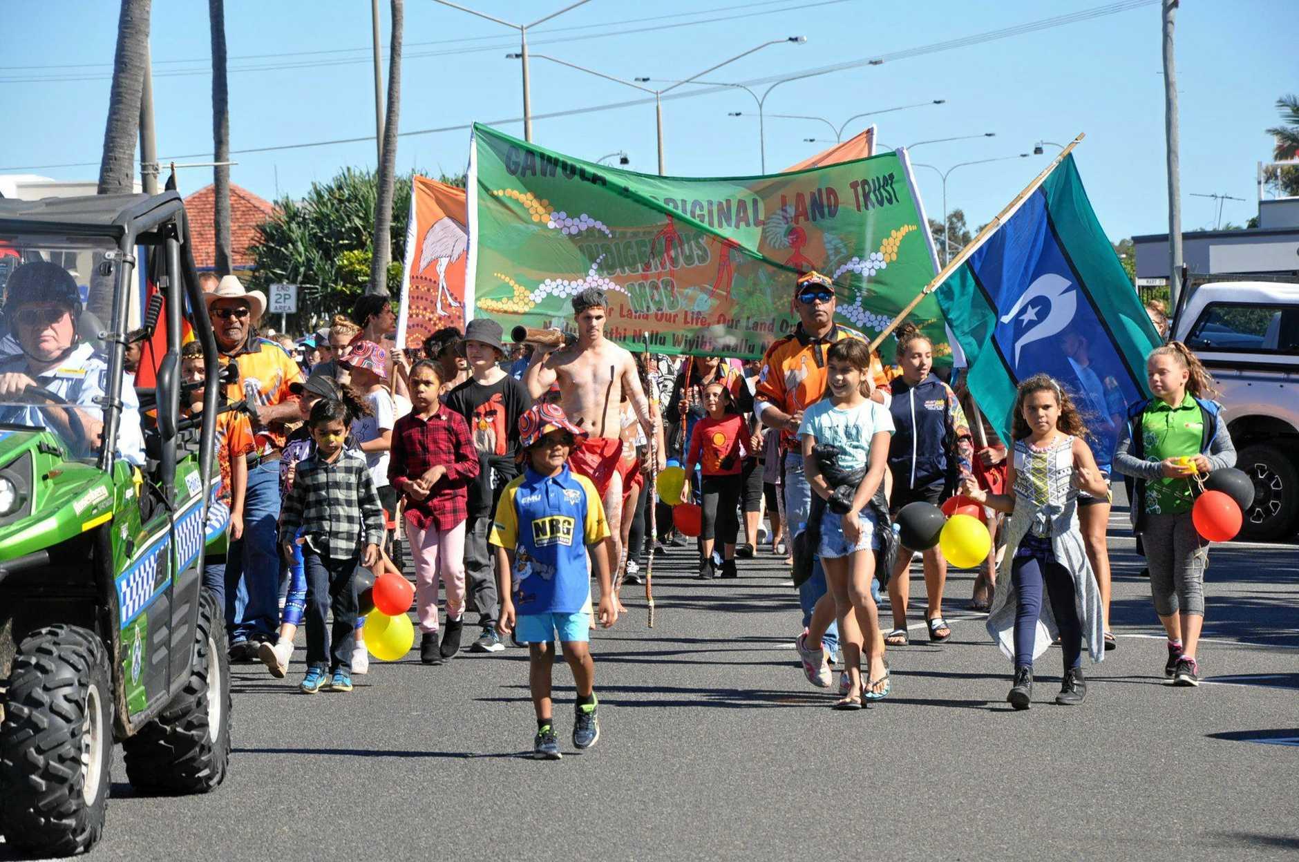Capricorn Coast Indigenous Mob march as part of NAIDOC Week celebrations.