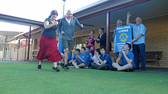 RUNNING ALONG: Biala Special School staff Bhavni Steward and Jed Grace get in some running practice, cheered on by the school's students and Ballina Lions Alex Martin and Jeff Spencer in preparation for this Sunday's Ballina Lions Fun-Run Walk.