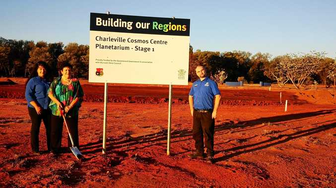 EXCITEMENT: Tourism manager Monique Johnson,  Mayor Annie Liston and Cosmos Centre co-ordinator Mike Dalley turn the soil for the new planetarium.