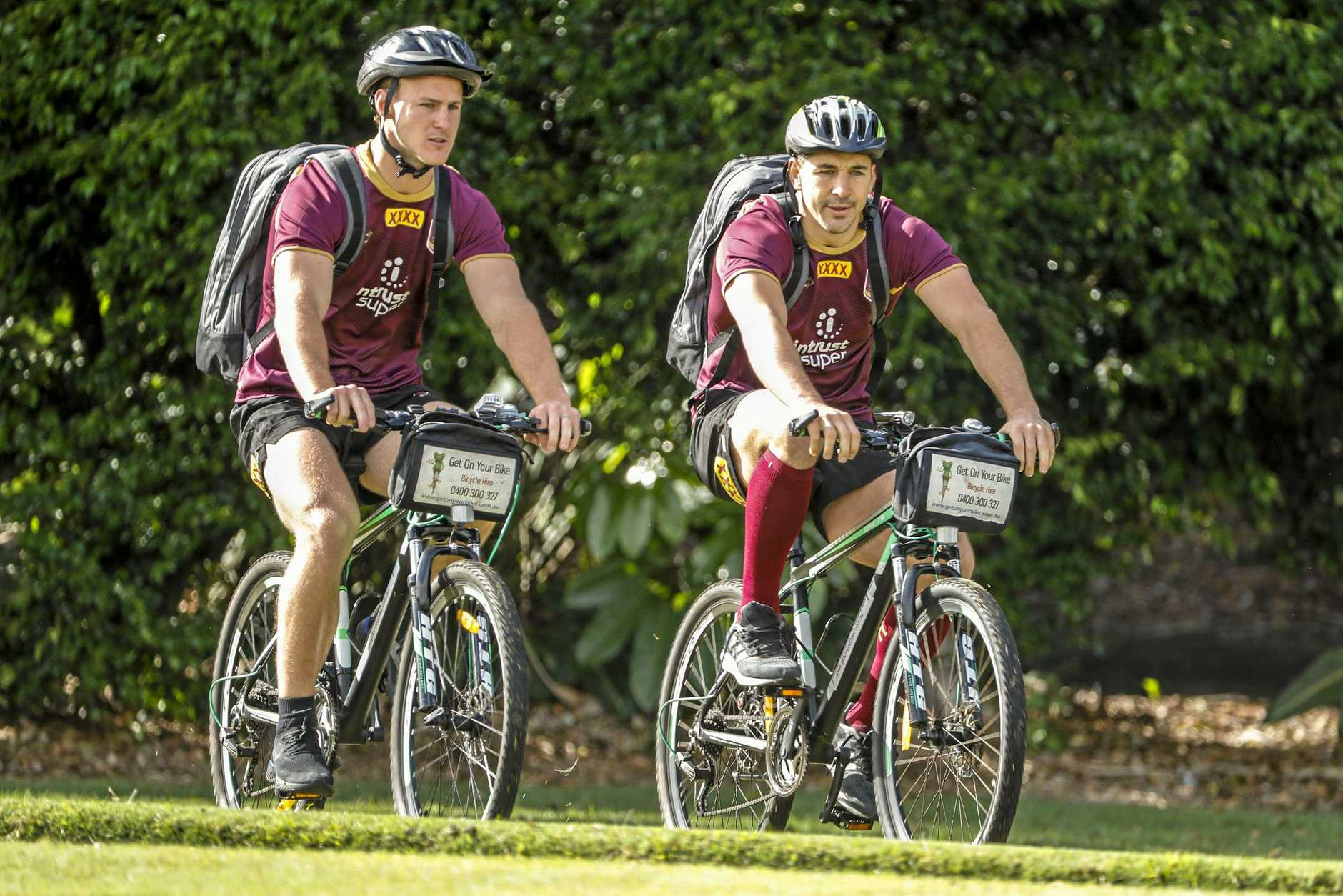 Daly Cherry-Evans and Billy Slater arrive for the Queensland Maroons team training session at the InterContinental Sanctuary Cove Resort on the Gold Coast, Thursday, July 5, 2018. Queensland are in camp to prepare for game three of the 2018 State of Origin series against the NSW Blues. (AAP Image/Glenn Hunt) NO ARCHIVING