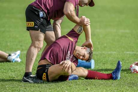 Billy Slater stretches out before joining in a training run.