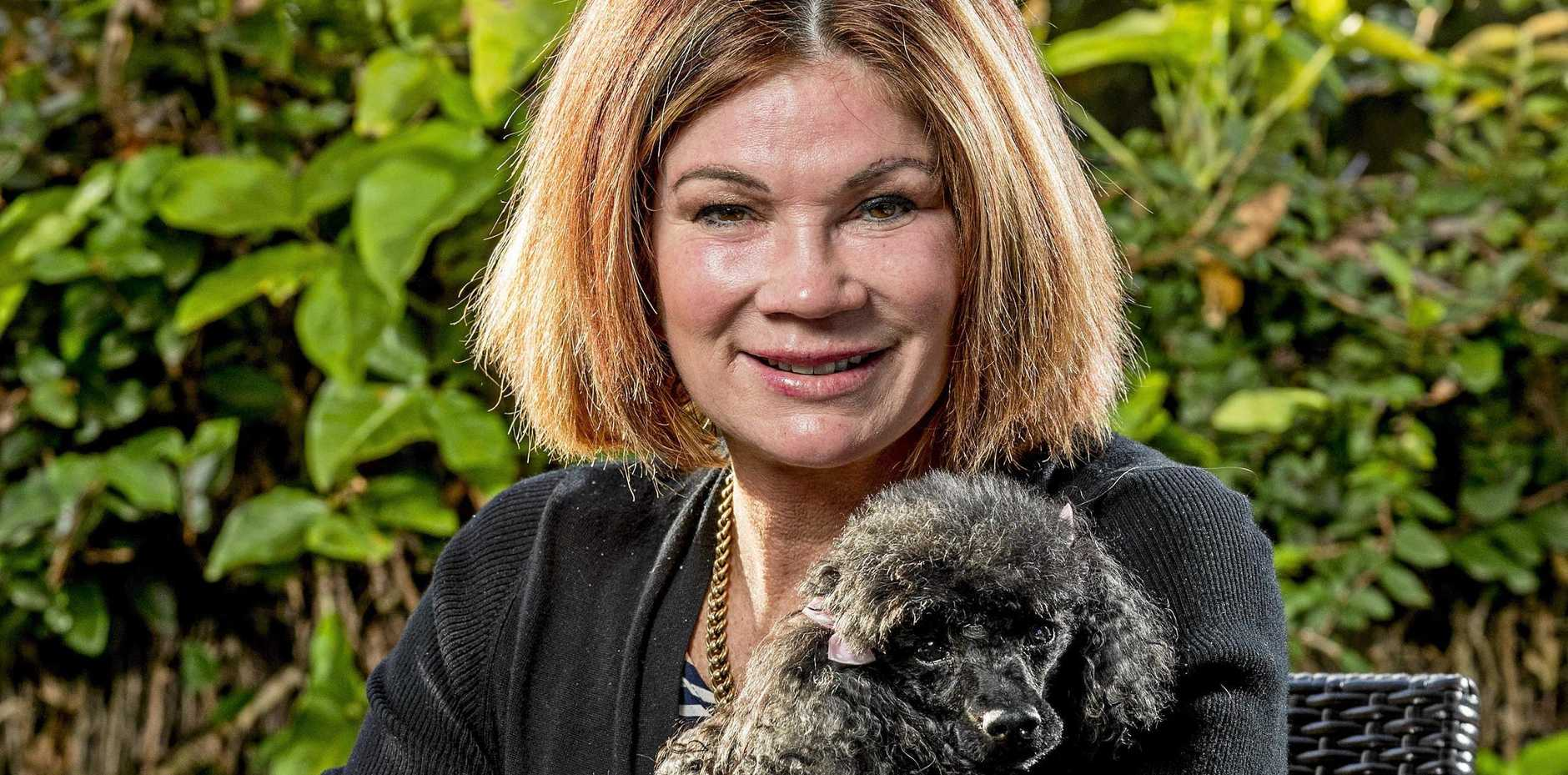 Tracey Wickham with her blind rescue dog Jemma, 12.