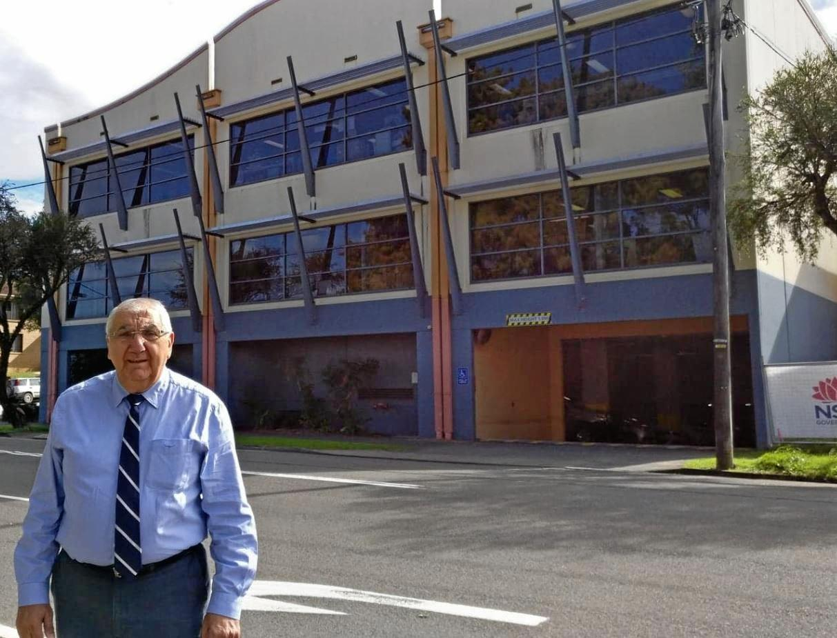 Lismore MP Thomas George in front of the Murwillumbah Firearms Registry.