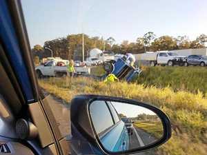 Bruce Hwy rollover creates traffic chaos