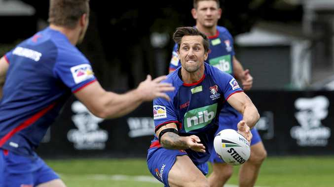 Mitchell Pearce directs proceedings at team training session in Newcastle on Tuesday. Picture: Darren Pateman/AAP