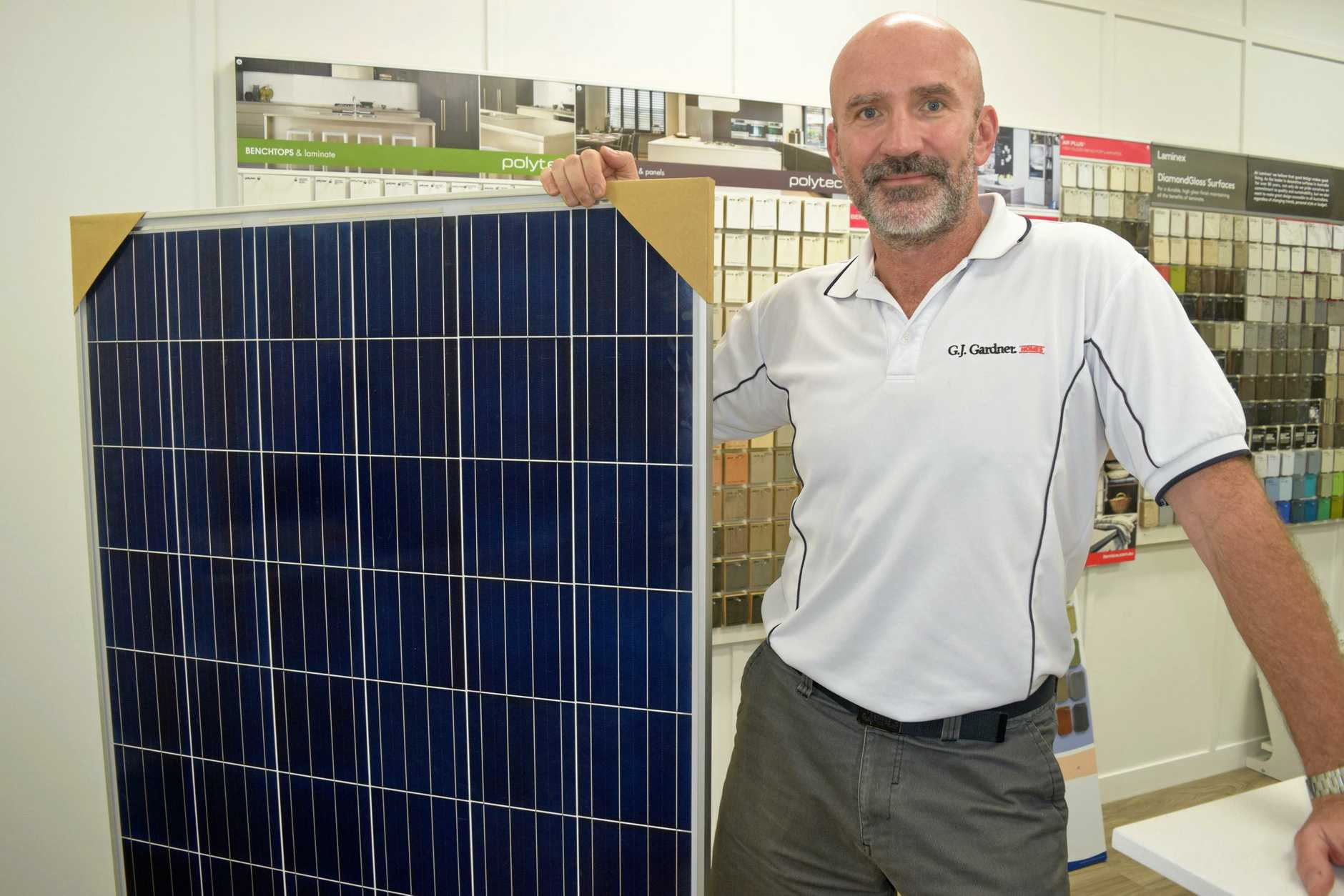 GYMPIE'S GJ Gardener franchisee Wojtek Stainwald with the new battery powered solar panels.