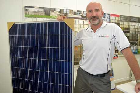 GYMPIE'S GJ Gardener franchisee Wojtek Stainwald with the new battery powered solar panels.