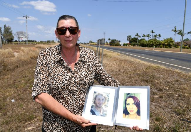 Kerri Walker with portraits of her children Daniel and Sarah, who were killed in the crash.