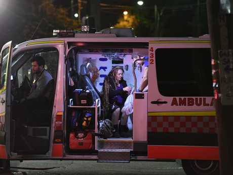Sharon Hacker sits inside an ambulance following the attack which she told the has left her with nerve pain and inability to sleep through the night. Picture: Gordon McComiskie