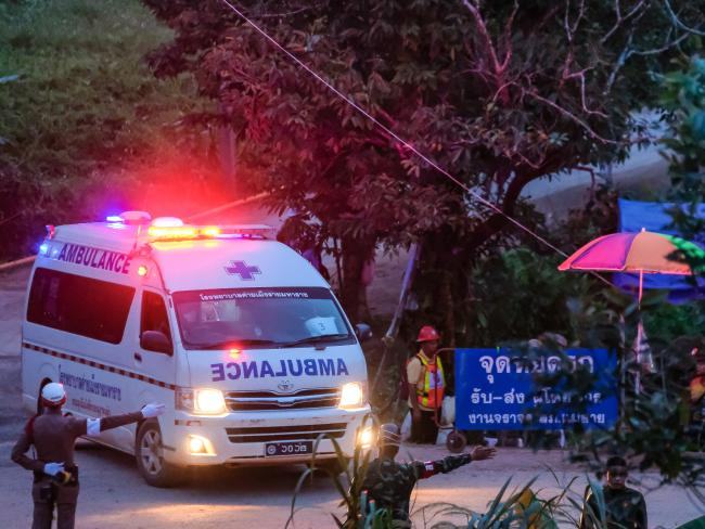 An ambulance carrying the sixth and seventh boys leaves the area. Picture: Getty Images
